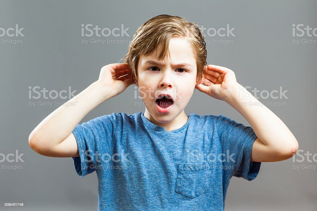 Little Boy Expressions - I can not Hear you stock photo