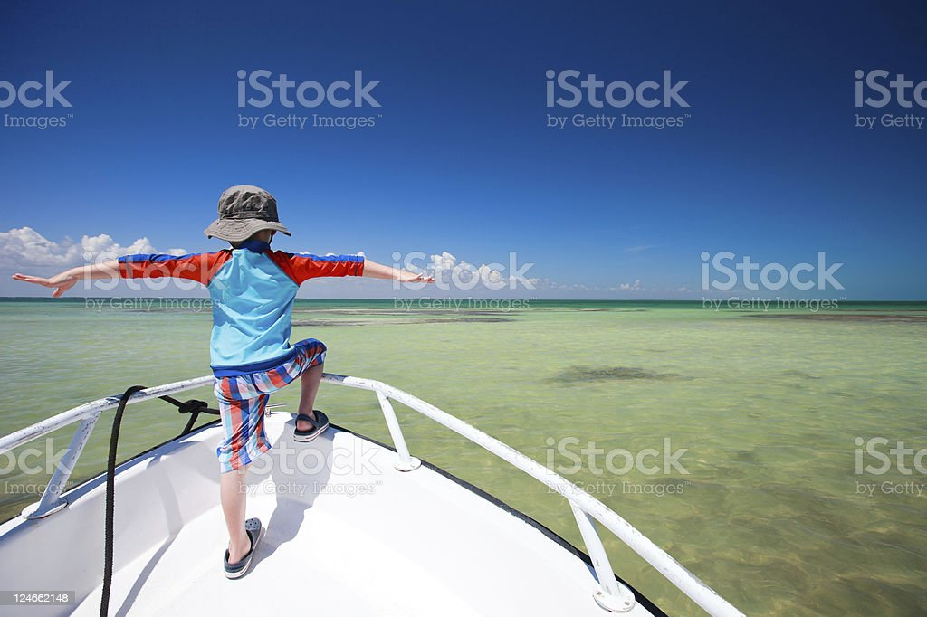 Little boy facing ocean royalty-free stock photo