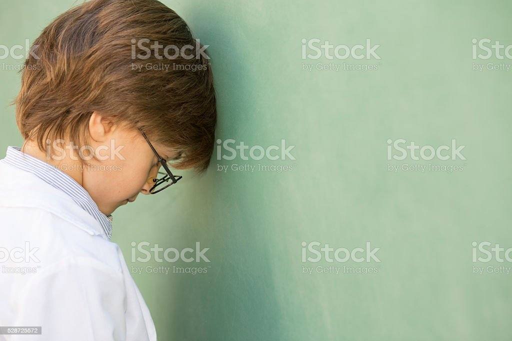 Little boy frustrated with school, education. stock photo
