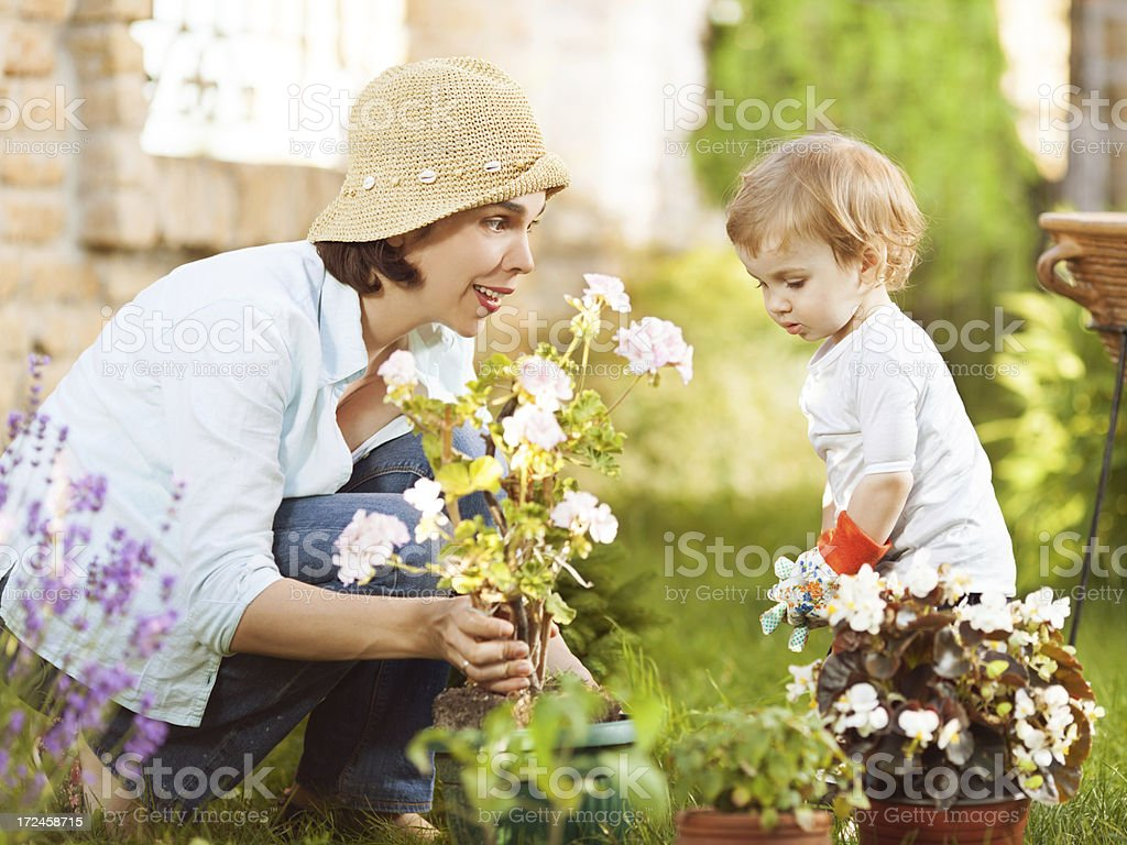 Little boy gardening with his mommy royalty-free stock photo