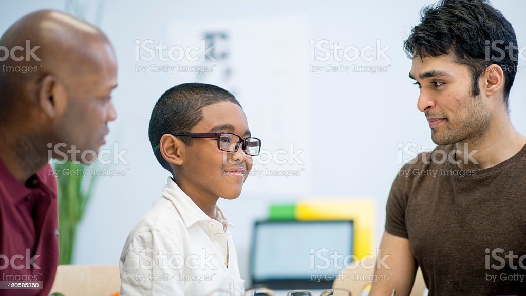 Little Boy gets New Glasses stock photo