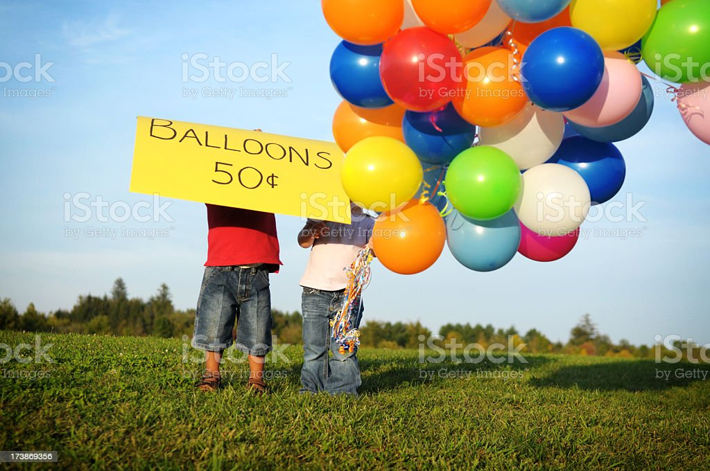 Little Boy & Girl Selling Balloons Outside royalty-free stock photo
