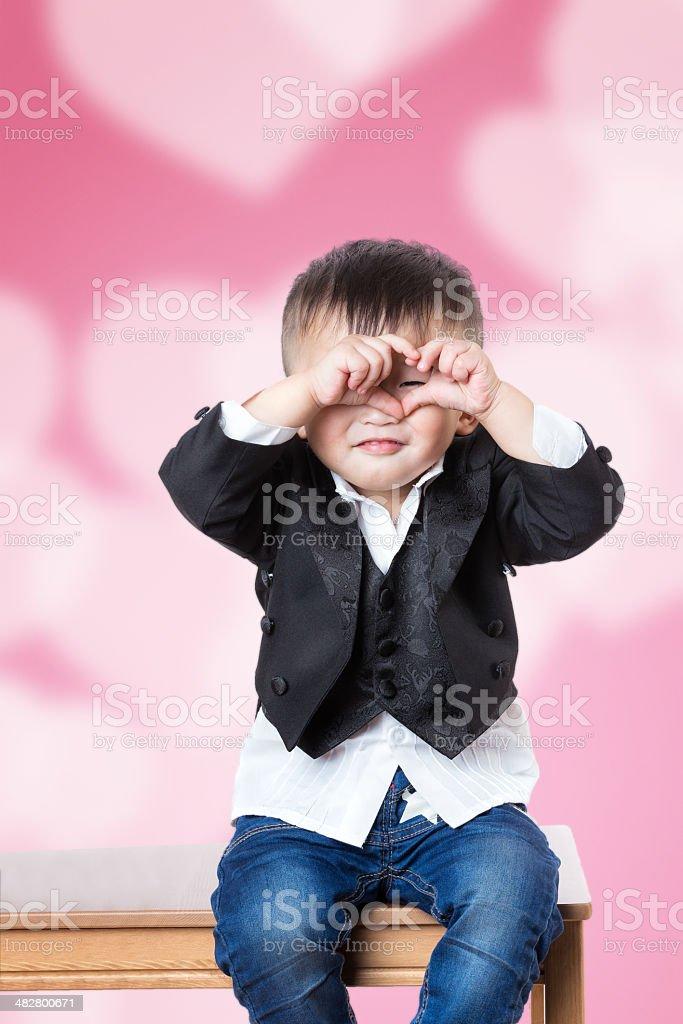 Little boy hands show signs of heart stock photo