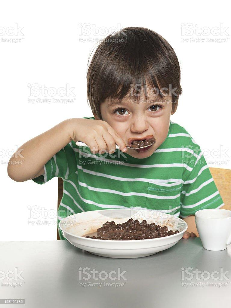 Little boy has his breakfast stock photo