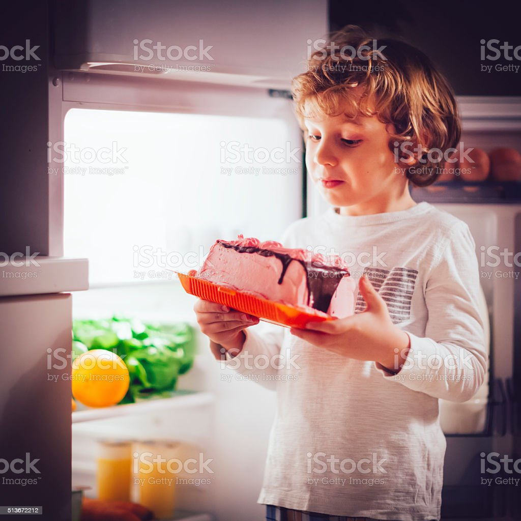 Little boy having a bedtime snack stock photo