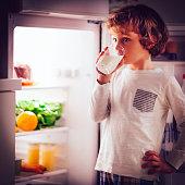 Little boy having a glass of milk