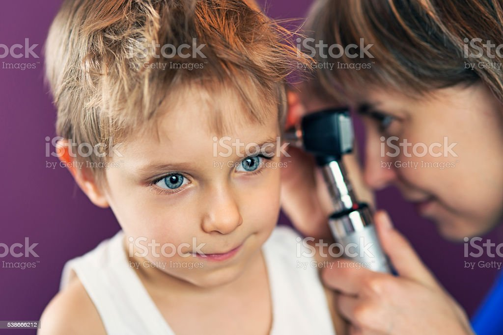 Little boy having an ear exam. stock photo