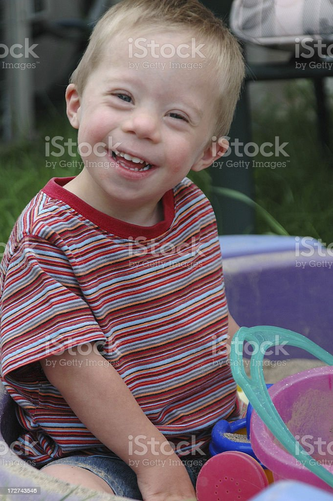 A little boy having fun in a sandbox royalty-free stock photo
