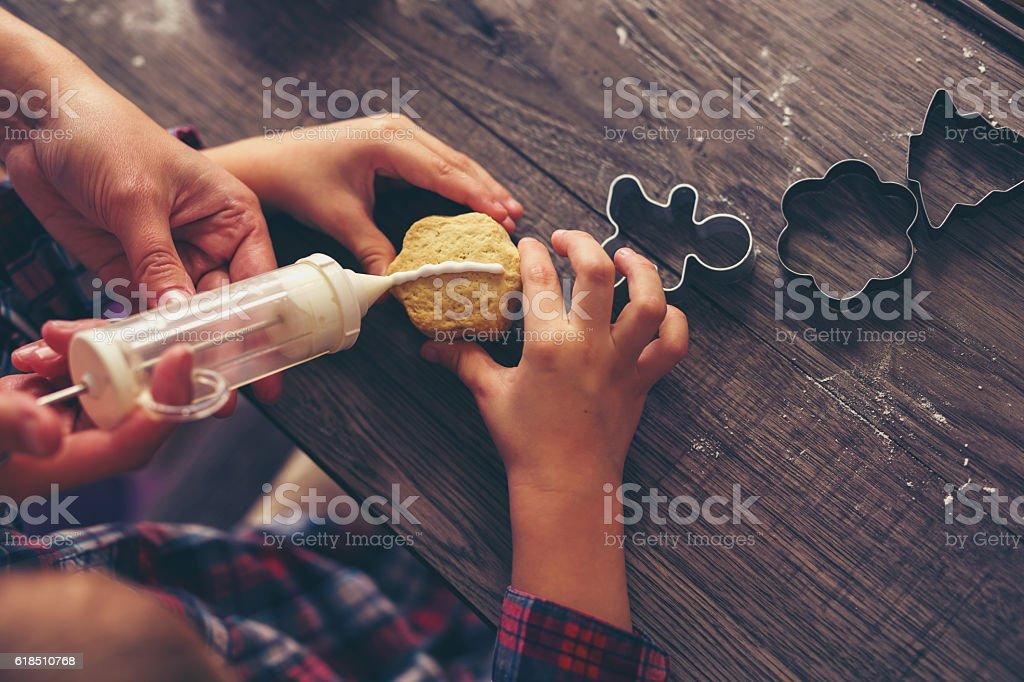 Little boy having fun in preparing Christmas cookies stock photo