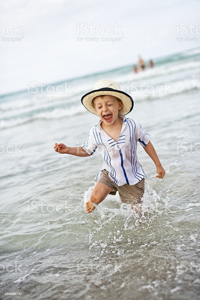 Little boy having fun in sea stock photo