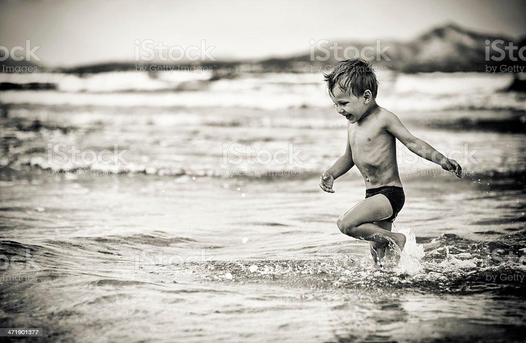 Little boy having fun in sea royalty-free stock photo
