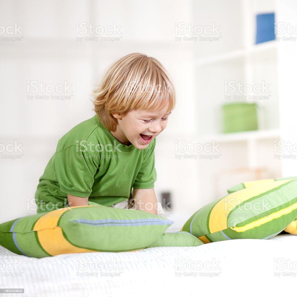 Little Boy having fun indoors, playing royalty-free stock photo