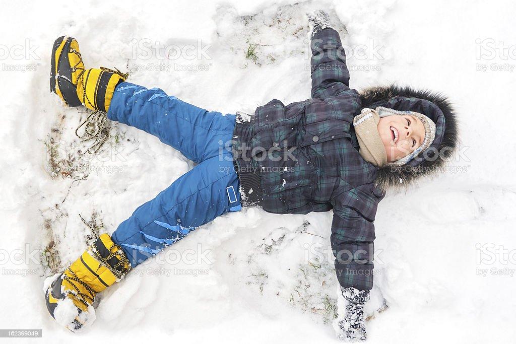 Little boy having fun on winter day stock photo