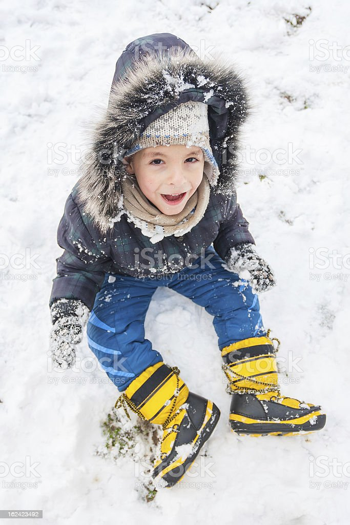 Little boy having fun on winter day royalty-free stock photo