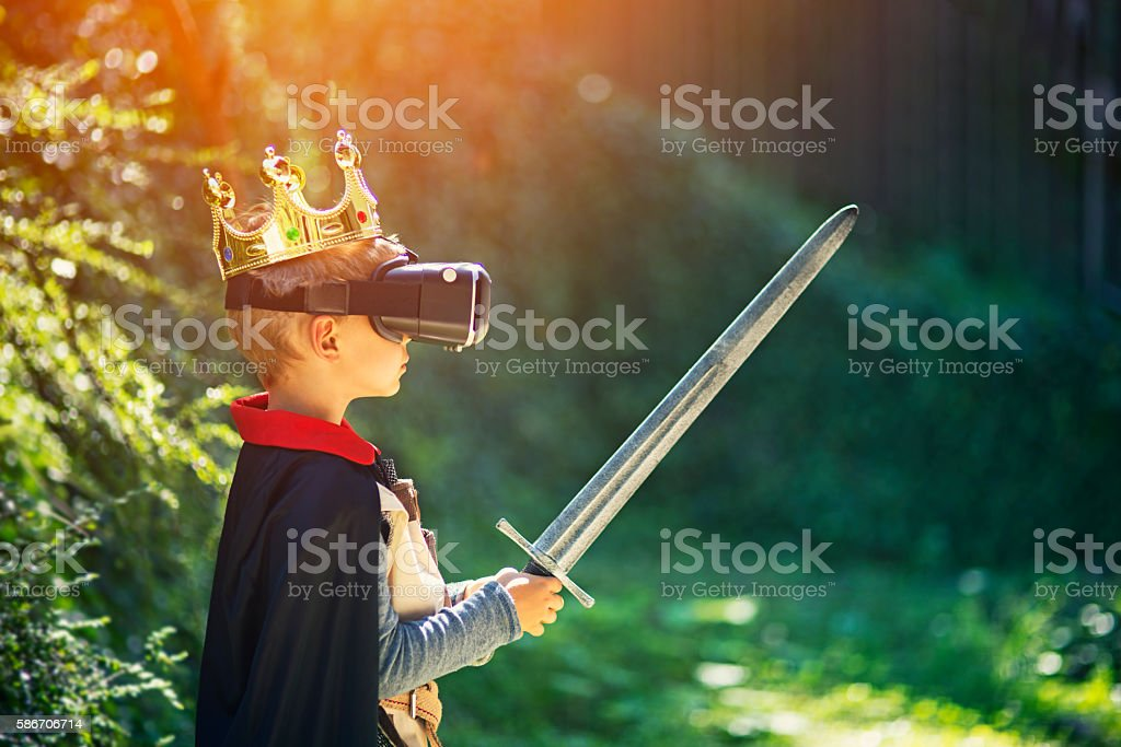 Little boy having fun playing with virtual reality headset stock photo