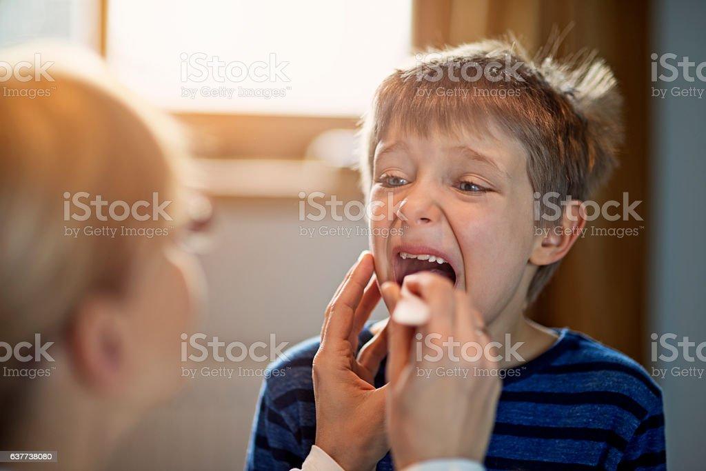 Little boy having medical examination stock photo