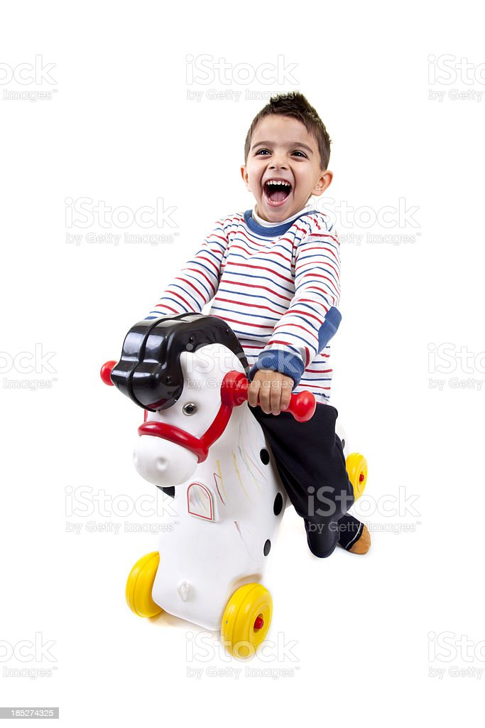 little boy having nice time with hobby horse royalty-free stock photo