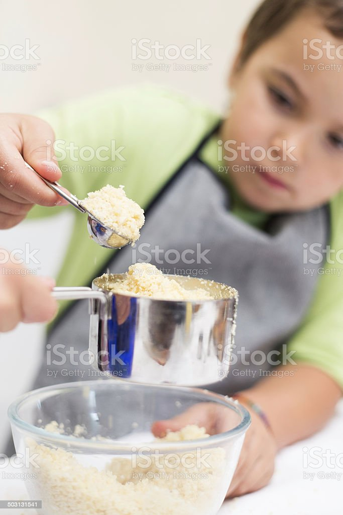 Little boy helping with the cooking stock photo