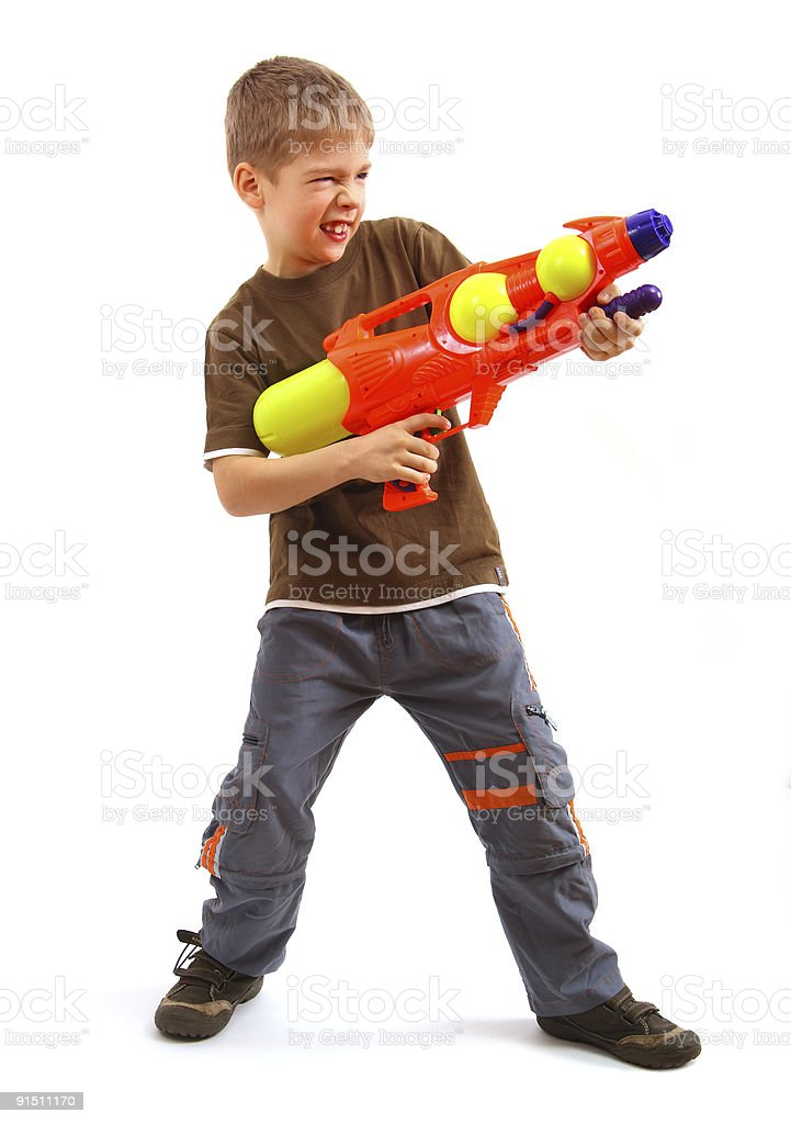 A little boy holding a brightly colored water gun stock photo