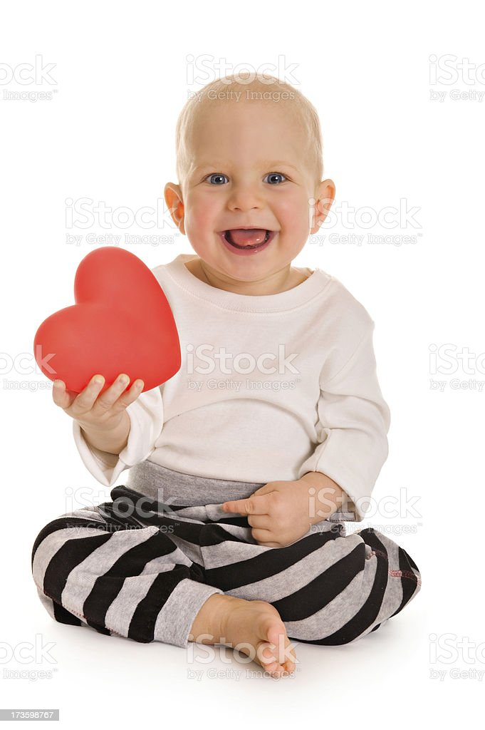 Little boy holding a heart stock photo