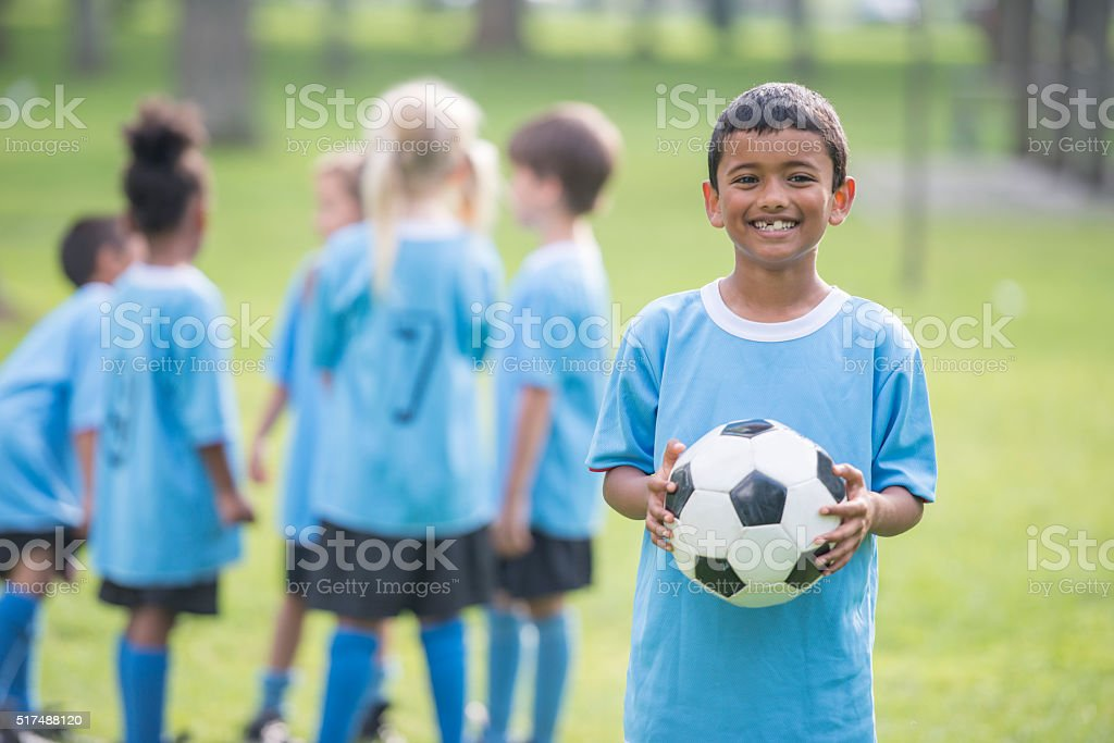 Little Boy Holding a Soccer Ball stock photo