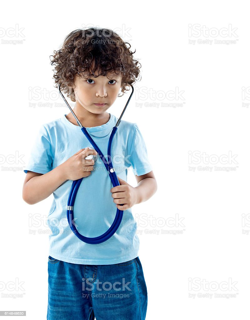 Little boy holding a stethoscope stock photo