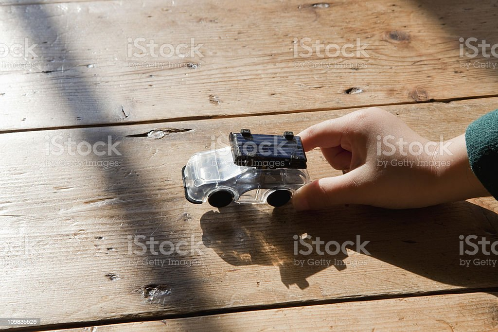Little boy holding a toy solar car. stock photo