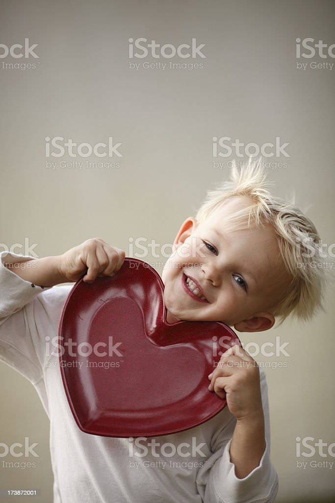 Little Boy Holding a Valentine Heart royalty-free stock photo