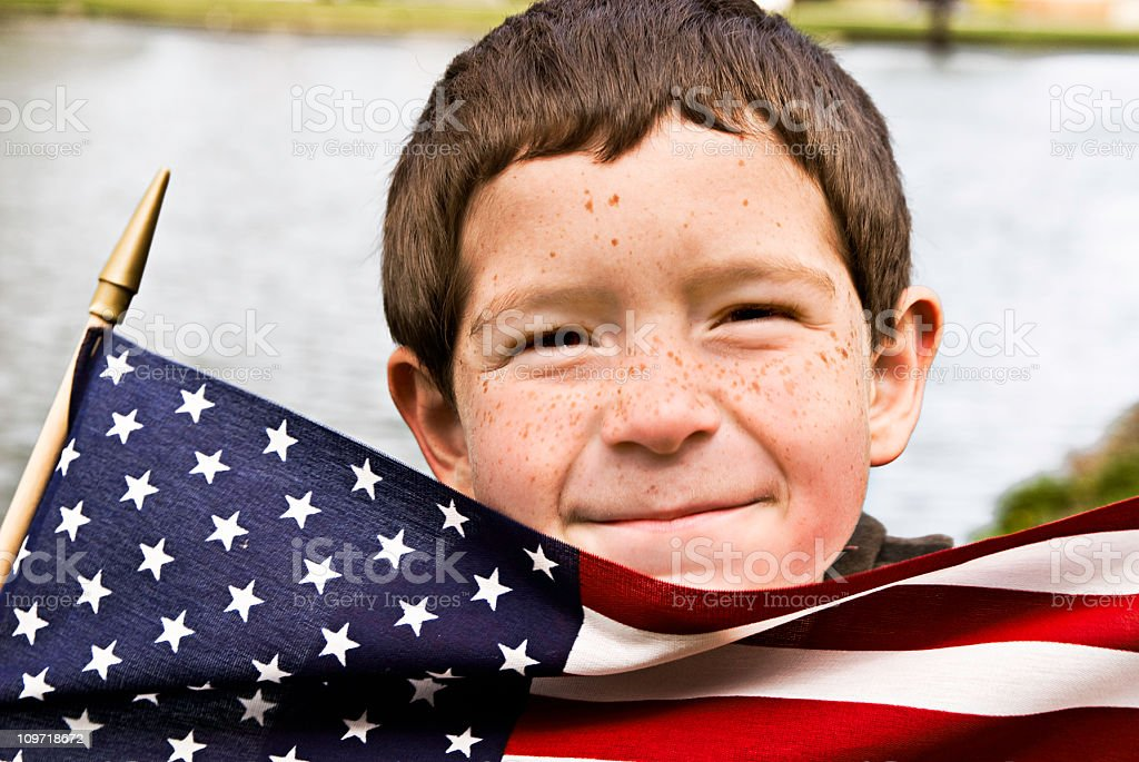 Little Boy Holding American Flag royalty-free stock photo