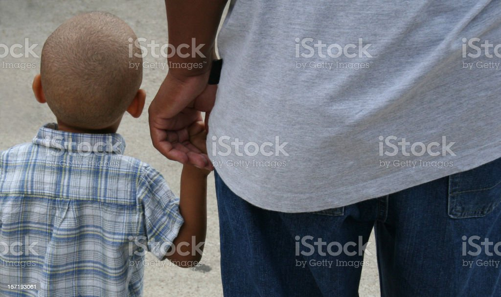Little Boy Holding Dad's hand royalty-free stock photo