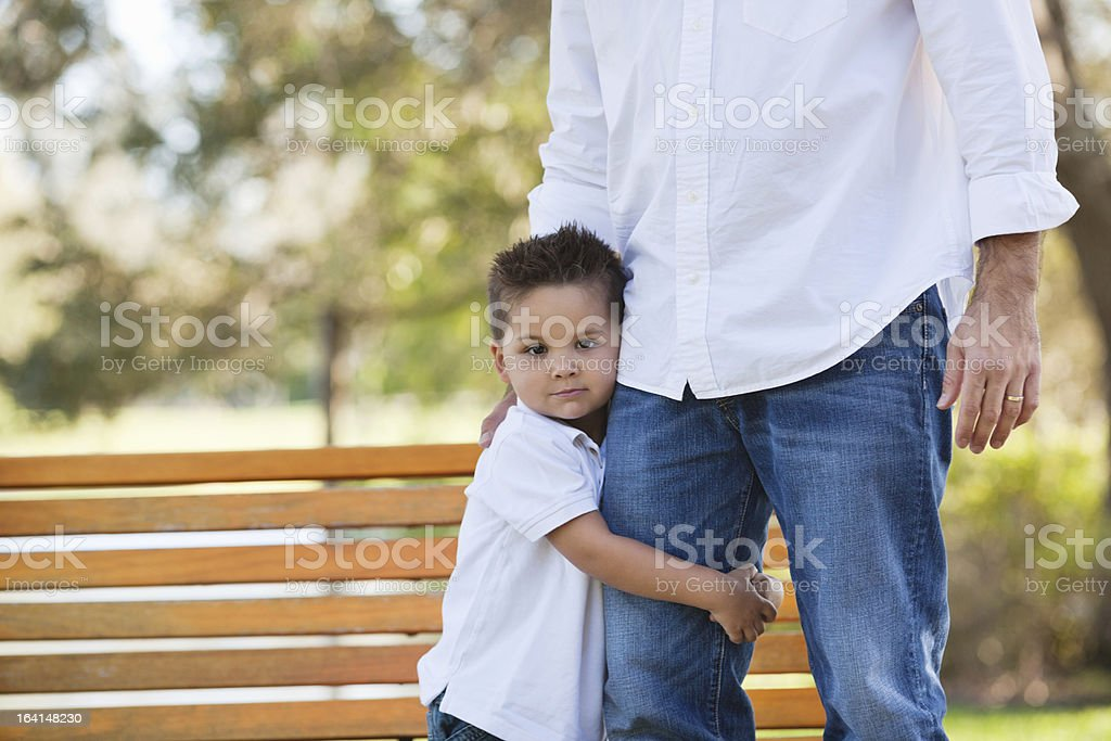Little Boy Holding Father's Leg At Park royalty-free stock photo