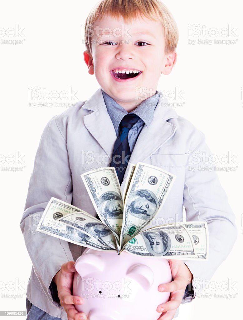 Little Boy Holding Piggy Bank with American Dollars stock photo