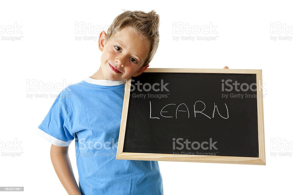 Little boy holding sign with the word learn royalty-free stock photo