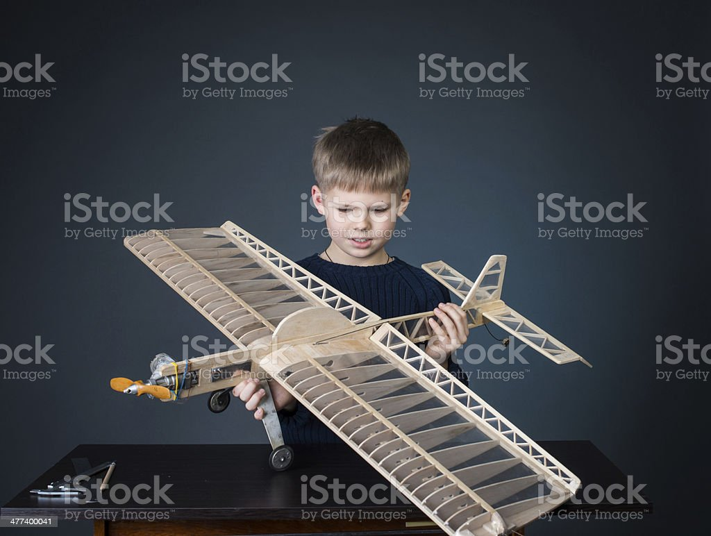 Little boy holding the model airplane. Hobby. stock photo