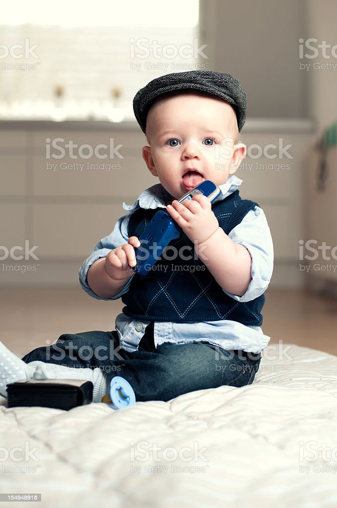 Little boy holds mobile phone royalty-free stock photo