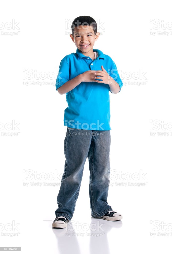 Little boy in a blue shirt and jeans stock photo