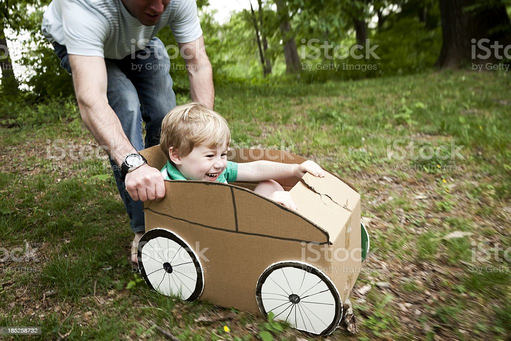 Little Boy in a Cardboard Car stock photo