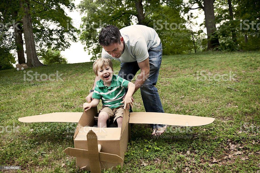 Little Boy in a Cardboard Plane royalty-free stock photo