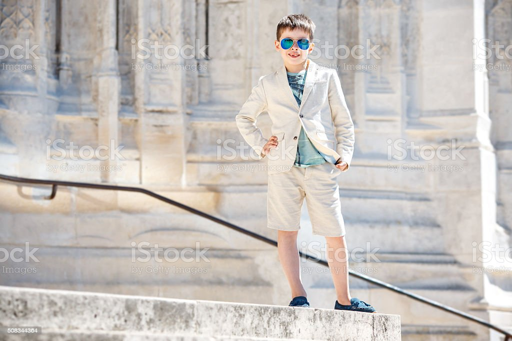 Little boy in a nice suit and glasses. Children portrait stock photo