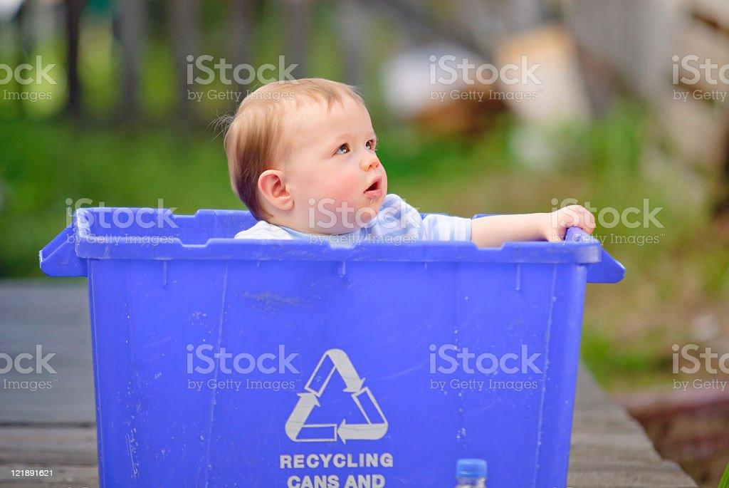 Little Boy in a Recycle Bin stock photo