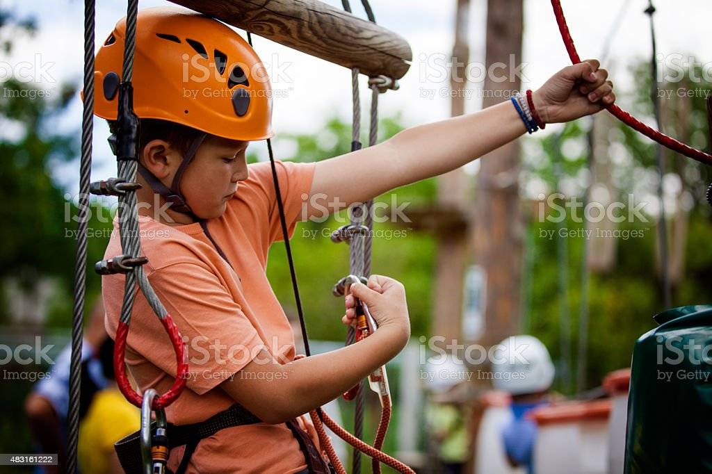 Little boy in adventure park stock photo