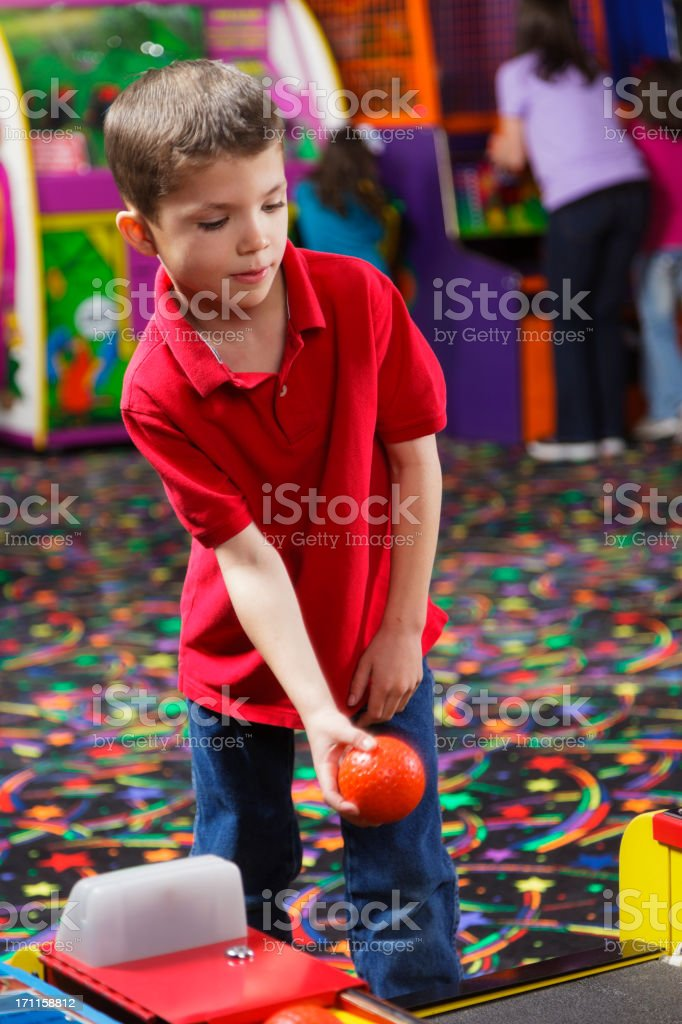 Little Boy in an Amusement Arcade royalty-free stock photo