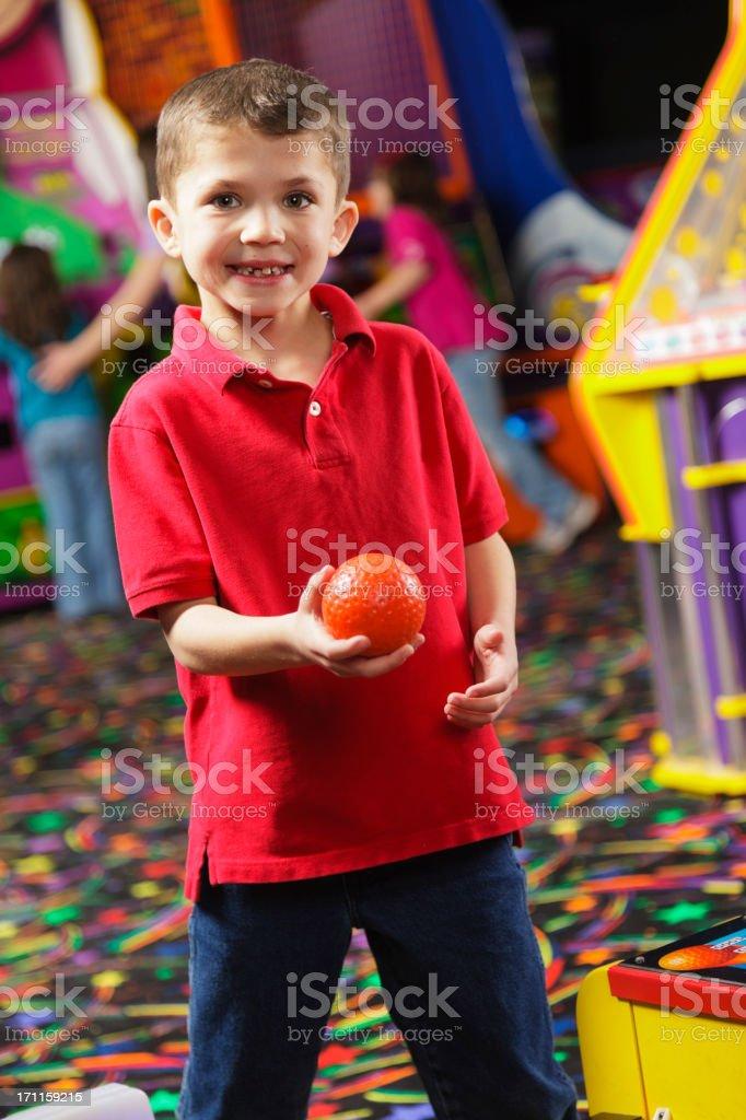 Little Boy in an Amusement Arcade stock photo