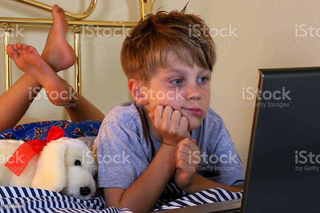 Little boy in bed with Laptop royalty-free stock photo