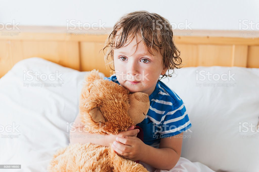 little boy in bedroom stock photo