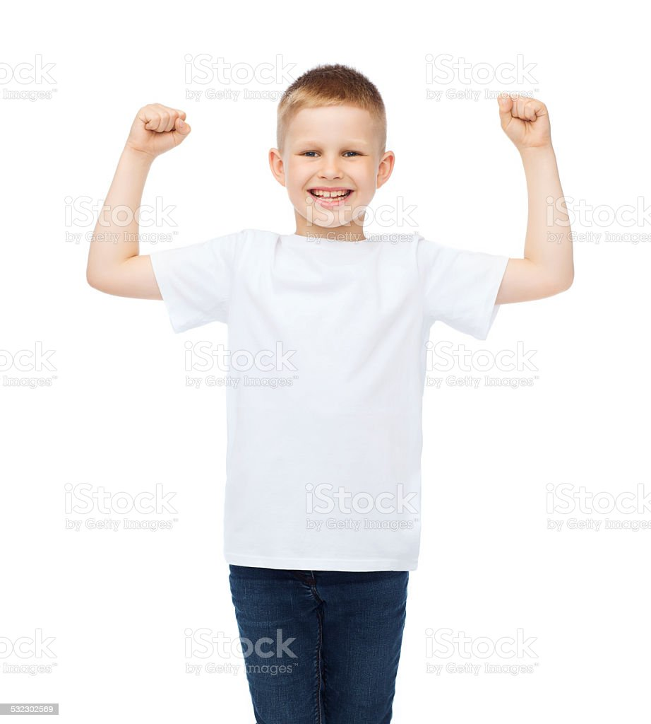 little boy in blank white t-shirt showing muscles stock photo