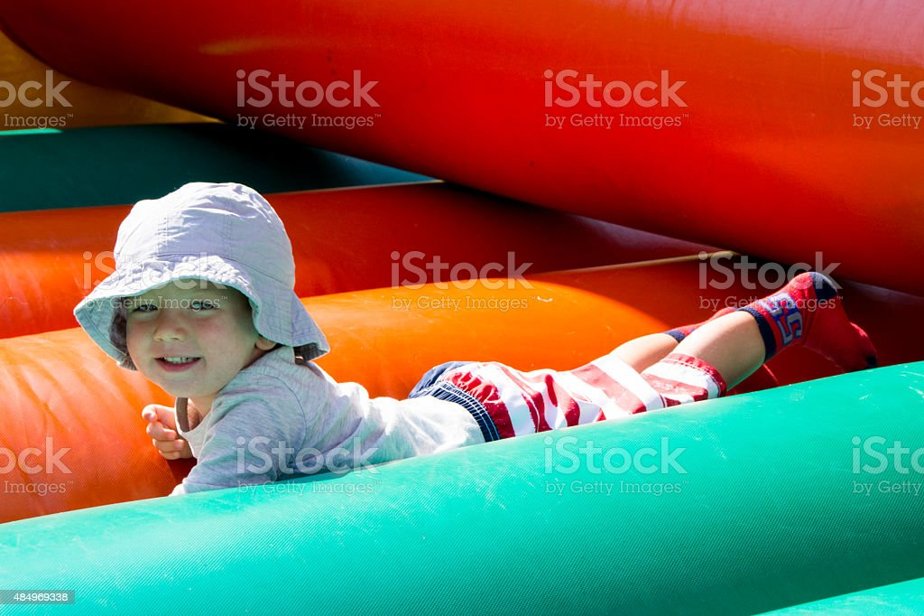 Little boy in Bouncy House at 4th of July Picnic stock photo