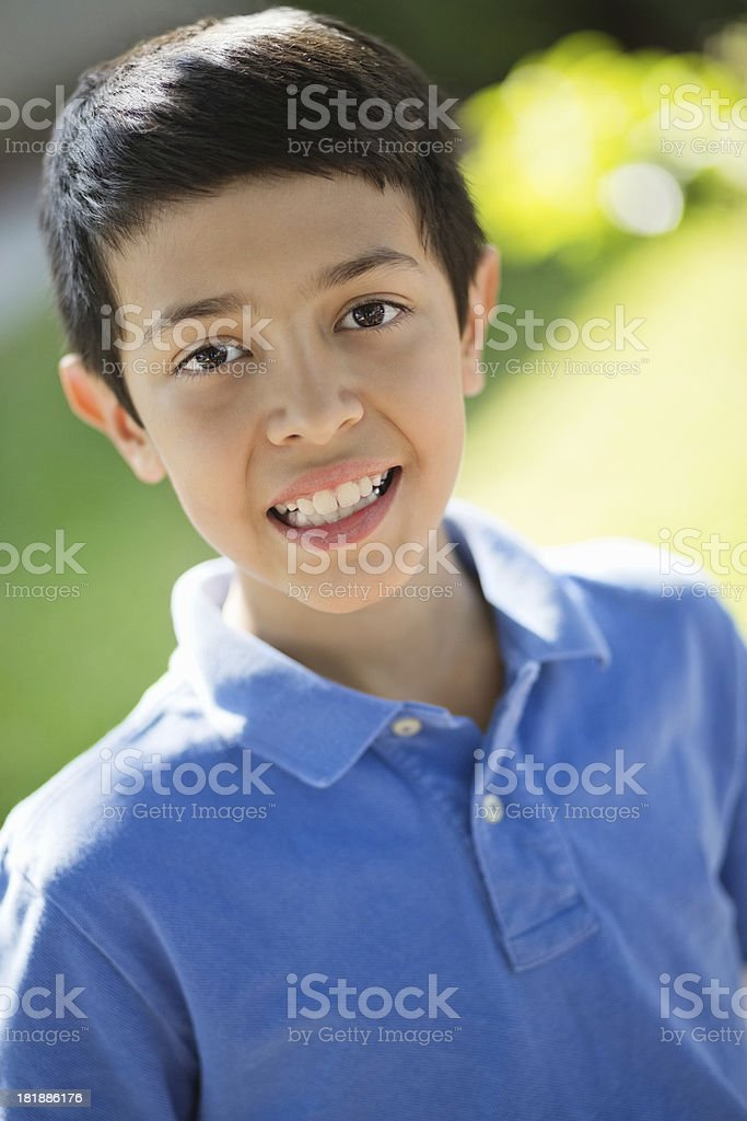 Little Boy In Casuals Smiling At Park royalty-free stock photo