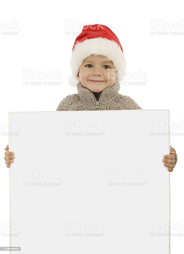 Little boy in Christmas hat with an empty banner royalty-free stock photo