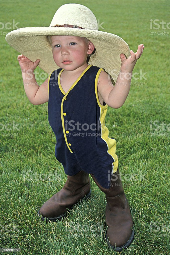 Little Boy in Dad's Hat & Boots royalty-free stock photo